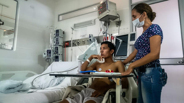 Johann Castro Hernandez, 18, is recovering from Guillain-Barre syndrome after he appeared to have fallen sick with Zika virus around New Year's. His mom, Janina Hernandez, is at right.