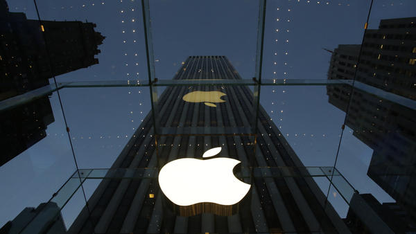The Apple logo is illuminated in the entrance to the Fifth Avenue Apple store in New York City. The company has until Feb. 26 to respond to the Justice Department's motion and an earlier court order.