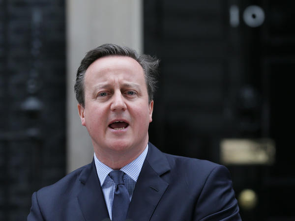 British Prime Minister David Cameron makes a statement outside 10 Downing Street in London on Saturday.