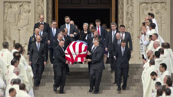 The casket containing the body of the late Supreme Court Associate Justice Antonin Scalia leaves the Basilica of the National Shrine of the Immaculate Conception in Washington following funeral mass services on Saturday.