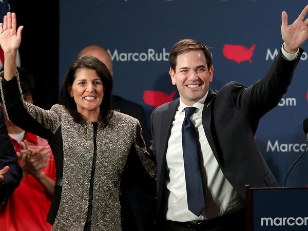 Republican presidential candidate Marco Rubio (R) and South Carolina Gov. Nikki Haley (L) celebrate after Rubio addressed supporters at a primary night event February 20 in Columbia, South Carolina.