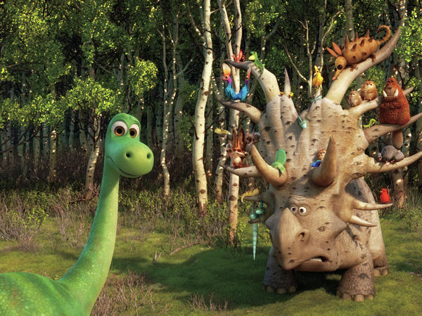 <em>The Good Dinosaur</em> is about an awkward, insecure dinosaur (Arlo, left) whose father tries to toughen him up.