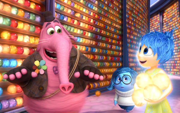 In one scene from <em>Inside Out,</em> Sadness (center) empathizes with forgotten imaginary friend Bing Bong (left) instead of trying to cheer him up, as Joy does.