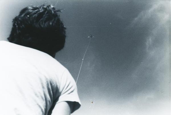 A student flies a kite.
