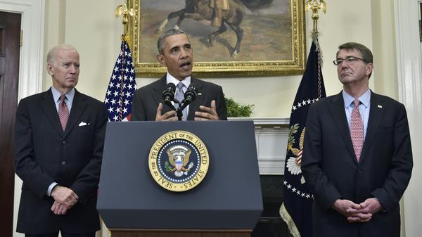 President Obama, flanked by Vice President Biden (left) and Defense Secretary Ashton Carter, delivers a statement on the Guantanamo Bay detention camp on Tuesday in the Roosevelt Room of the White House.