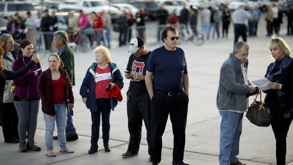 Voters line up outside a Republican caucus site in Las Vegas on Tuesday, a day that was won handily by Donald Trump.