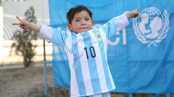 """Murtaza Ahmadi, 5, is the proud new owner of a genuine Lionel Messi jersey. Earlier this year, a photo of the boy wearing a """"Messi"""" jersey made from a plastic bag went viral."""
