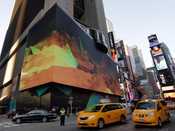 Traffic passes the giant animated billboard on the facade of the Marriott Marquis Hotel, in New York's Times Square.