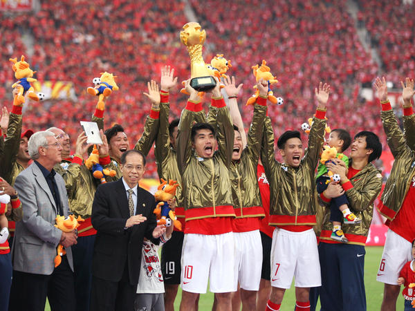 Guangzhou Evergrande players celebrate after winning the 2013 Chinese Super League title. The club has won the last five titles.