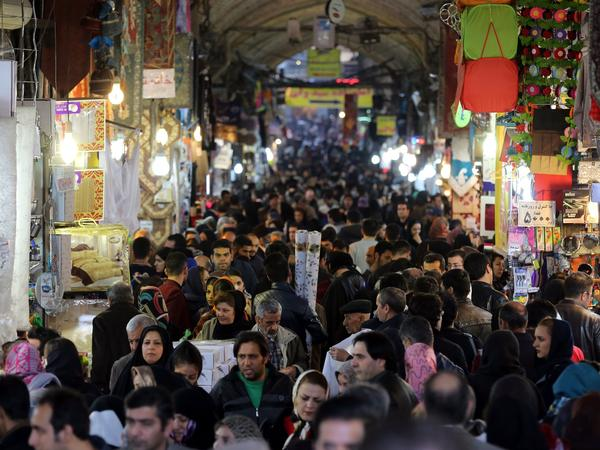 "Iranians shop in Tehran's ancient Grand Bazaar on Jan. 16, 2016, the day many sanctions were lifted as part of a nuclear deal. President Rouhani called the deal a ""golden page"" in Iran's history."