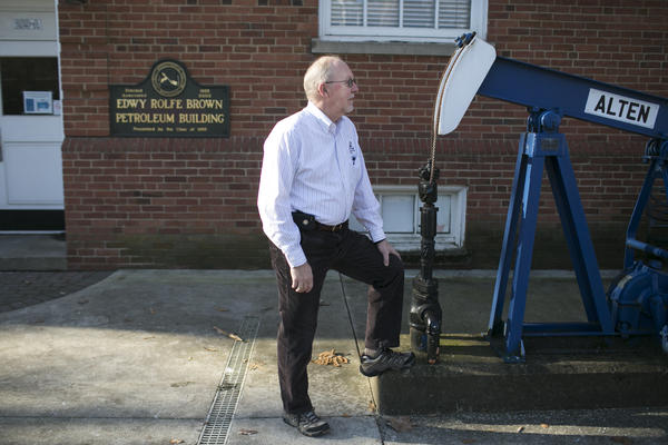 Dr. Robert Chase, former chair of the petroleum engineering program Marietta College, stands next to an oil rig on campus in Marietta, Ohio.
