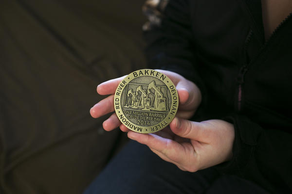Debee holds a medal she received during her internship.