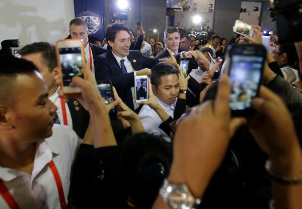 "Trudeau, surrounded by admirers at November's Asia-Pacific Economic Cooperation summit in Manila, the Philippines, was dubbed a ""hottie"" by the Filipino media."