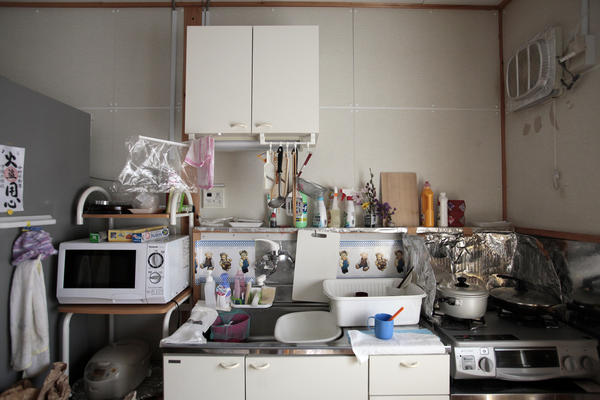 The kitchen of one of the temporary homes. Often, the evacuees find themselves living in much smaller spaces than they used to occupy.