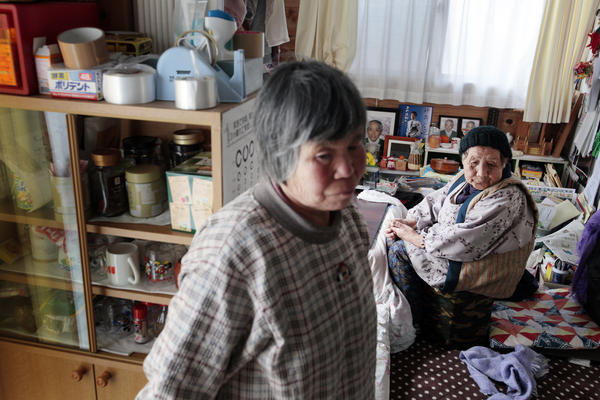 Saki Sato (left), 77, and Chikuyo Yokoyama, 90, are neighbors in the housing project, and visit during the day. Sato lives alone, and Yokoyama lives with her son.