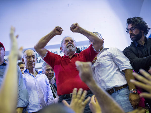Brazilian prosecutors are seeking the arrest of former President Luiz Inacio Lula da Silva, shown here during a rally on March 4 in Sao Paulo. He is accused of corruption and embezzlement.