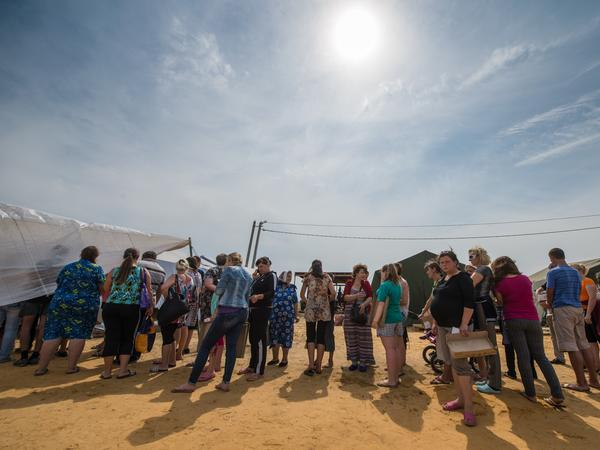 Refugees from eastern Ukraine queued to get food in a refugee camp near the city of Donetsk, near the Russian-Ukrainian border, in August 2014.