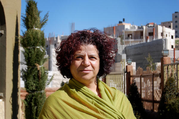 Palestinian Abla Masrujeh, outside her home near Nablus, in the West Bank, says she changed from believing peace was possible to giving up hope. She says firsthand experience caused her shift in belief.