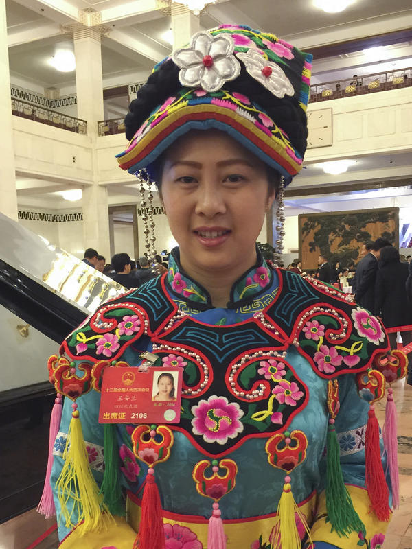 Wang Anlan, a 28-year-old National People's Congress delegate from the ethnic Qiang minority, poses for a picture in the Great Hall of the People.