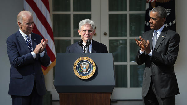President Obama and Vice President Biden stand with Judge Merrick B. Garland as he is nominated to the U.S. Supreme Court on Wednesday at the White House Rose Garden.
