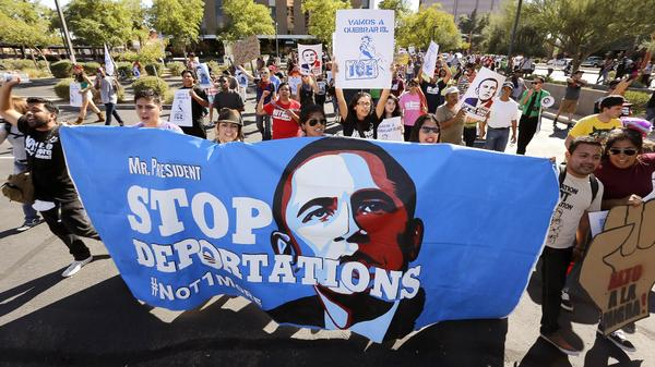 Hundreds protest President Obama's immigration policy, marching to the U.S. Immigration and Customs Enforcement office in Phoenix in 2013. Many Latinos who supported the president have become frustrated by his administration.
