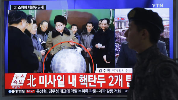 "A South Korean army soldier walks by a TV screen showing North Korean leader Kim Jong Un with superimposed letters that read: ""North Korea's nuclear warhead."" The warhead was later jokingly dubbed ""the disco bomb."""