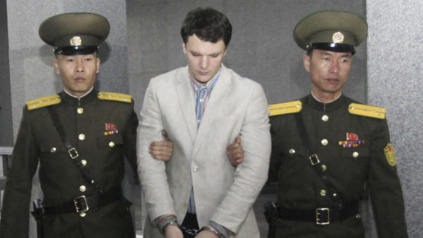 American student Otto Warmbier is escorted at the Supreme Court in Pyongyang, North Korea, on March 16. He was sentenced to 15 years of hard labor for subversion after he allegedly stole a propaganda poster.