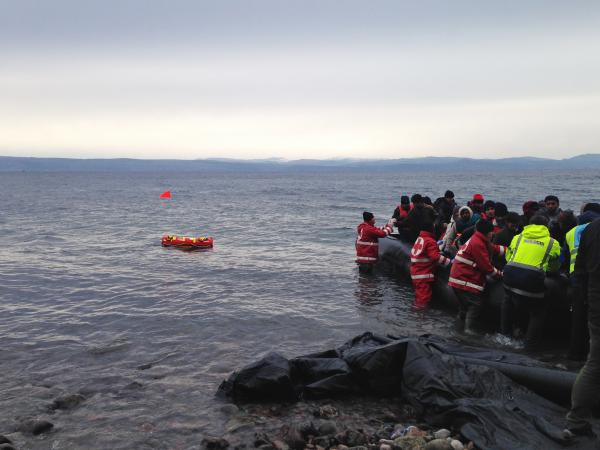 Members of the Hellenic Red Cross and trainers from the U.S. deploy Emily to help a distressed raft loaded with migrants.