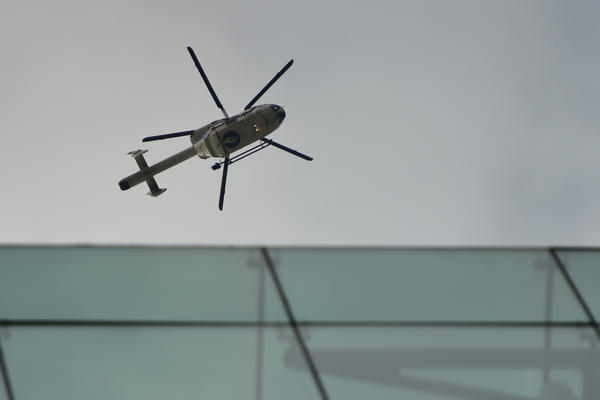 A police helicopter flies in the area of the Maelbeek metro station after Tuesday's attack. Trains were halted, and the city went into lockdown.