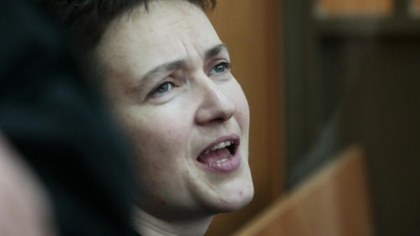 Ukrainian pilot Nadezhda Savchenko speaks in court, where she was sentenced to 22 years in prison for the deaths of two Russian journalists. She says there is proof she had already been taken prisoner before they died.