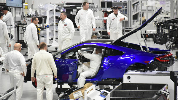 Technicians and engineers work on a 2017 Acura NSX at the Honda Motor Co. Acura Performance Manufacturing Center in Marysville, Ohio, on March 8.