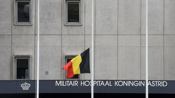 The Belgian flag flies at half-mast at the Koningin Astrid-Reine Astrid military hospital in Brussels on March 24, 2016. Some of the people wounded in the Brussels attacks are being treated there.