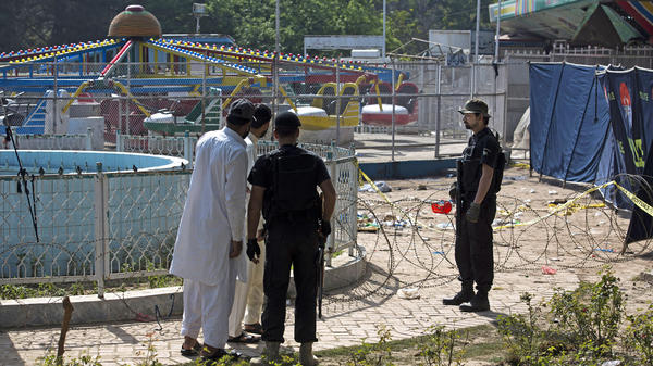 Pakistani police on Monday cordon off the scene of the suicide bombing at a park in Lahore.