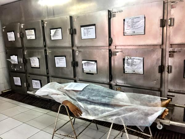 A murder victim at the morgue in the northern Brazilian city of Natal. Brazil has close to 60,000 murders a year, the highest number in the world, according to officials there. Though most victims are shot to death, some lawmakers are pushing to ease gun restrictions, making arguments similar to ones in the U.S.