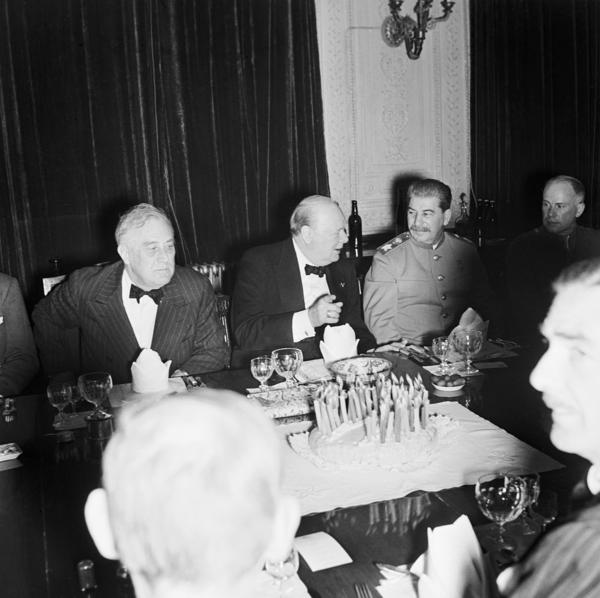 Churchill (center) celebrates his 69th birthday at a dinner party with President Franklin Delano Roosevelt (left) and Soviet leader Joseph Stalin at the British Legation in Tehran, Nov. 30, 1943. A great friend, Stalin would send Churchill caviar on his birthday — until they fell out over Churchill's Iron Curtain speech.