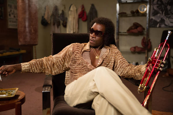 """Don Cheadle plays Miles Davis in the movie <em>Miles Ahead. </em>Cheadle's portrayal is being hailed as capturing the """"badass"""" swagger that made Davis a hero to generations of black men."""
