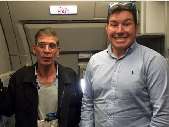 "Ben Innes (right) poses for a picture with EgyptAir hijacker Seif Eldin Mustafa. Despite not actually being a selfie, it's known as the ""hijack selfie."""
