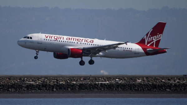 A Virgin America plane lands at San Francisco International Airport.