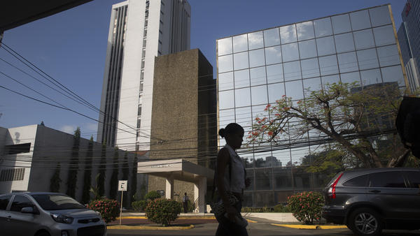 A pedestrian walks past the building housing the offices of Mossack Fonseca in Panama City, Panama, on Tuesday. The massive trove of emails, contracts and other papers from the law firm is being called the largest document leak in history.