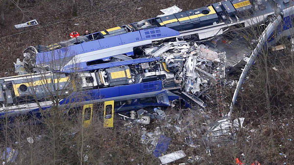 On Feb. 9, rescue teams work at the site where two trains collided head-on near Bad Aibling, Germany. A dispatcher whose errors allegedly caused the crash has been arrested after he admitted playing a game on his cellphone while he was working on the morning of the crash.