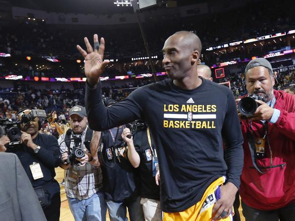 Los Angeles Lakers forward Kobe Bryant waves as he leaves the court after a game against the New Orleans Pelicans in New Orleans on April 8.