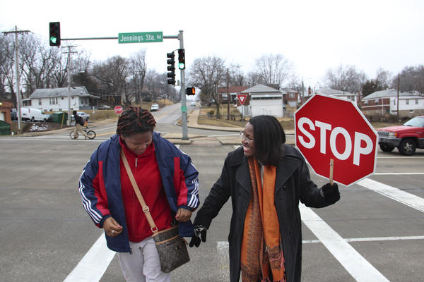 Tiffany Anderson (right), superintendent of the Jennings School District in north St. Louis County, Mo., performs crosswalk duty every morning to save the district money.