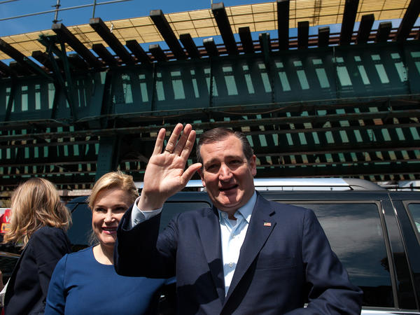 Standing in front of elevated subway tracks, Republican presidential hopeful Ted Cruz waves, as he arrives at the Sabrosura 2 restaurant in The Bronx, N.Y. April 6.