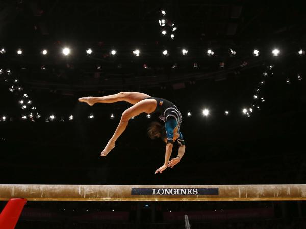Larisa Andreea Iordache of Romania performs on the balance beam during the 2015 World Gymnastics Championships in Glasgow, Scotland.