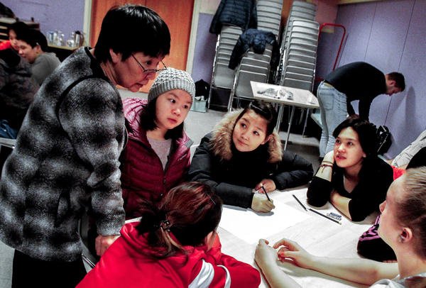 Guidance counselor Alice Pivat talks to 15-year-old girls during a suicide prevention class in Tasiilaq.
