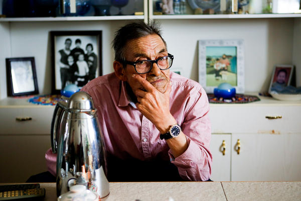Atsa's husband, Jan Schmidt, sits in the couples' Nuuk living room.