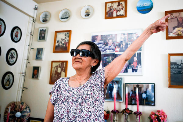 Atsa Schmidt describes the old family pictures that line the walls and shelves of her house.