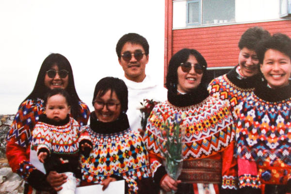 Anda Poulsen, in white jacket, poses for a portrait with his fellow 1989 graduates of Greenland's school of social work in Nuuk.