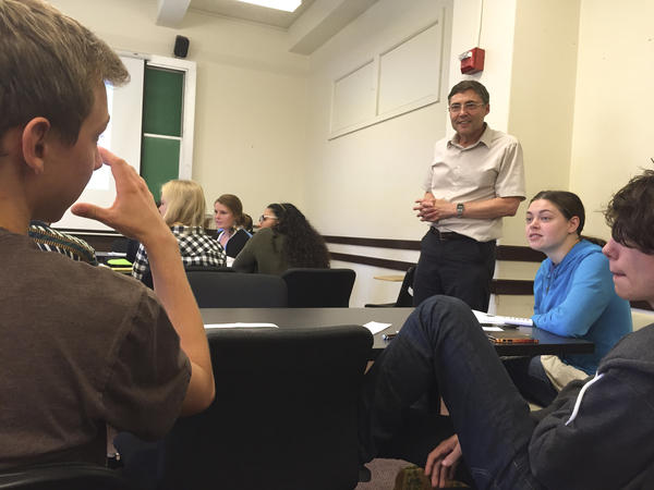 Dr. Carl Wieman listens in on a small group discussion during his introductory quantum mechanics course at Stanford University.
