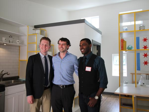 Lon Stousland (left,) Marty Sandberg and Terry Howell are the winners of the American Institute of Architects tiny homes competition. They posed inside the prototype of their design.